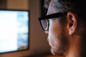 serious man in glasses using computer and looking PTSH2X3 300x200 - Domain, Hosting and Email